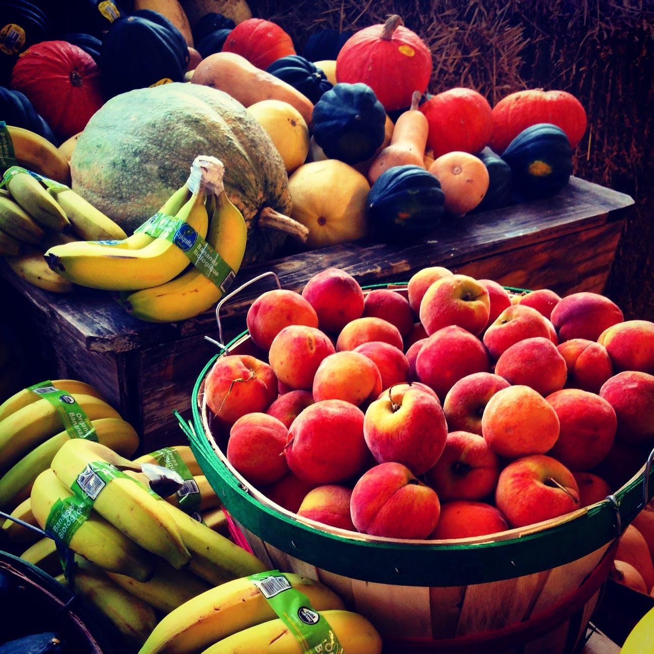 red apples in brown wooden bucket